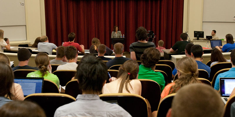 Speaker talking with students in auditorium