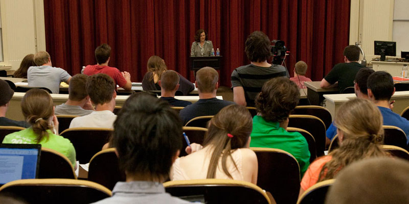 Professional woman speaks to a crowd of students