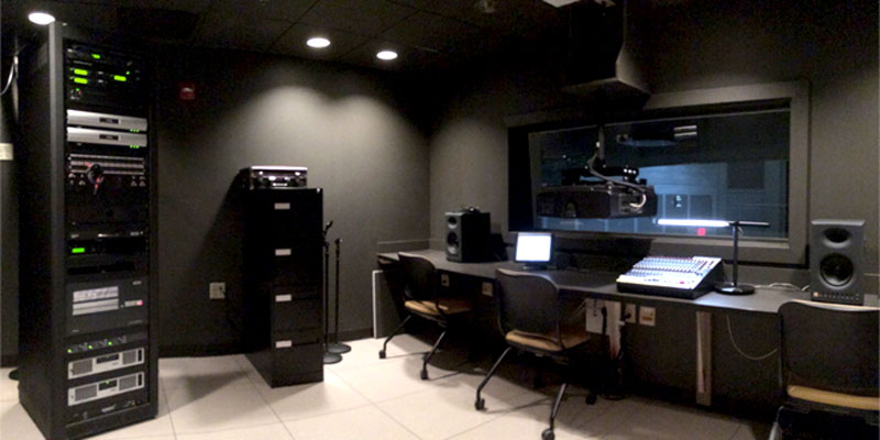 Dark room with computer servers and computers