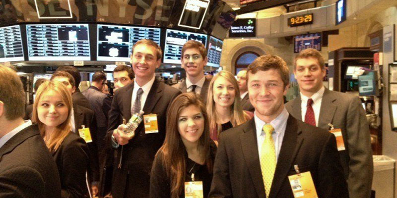 Students visiting Wall Street dressed in business suits during Wall Street Week