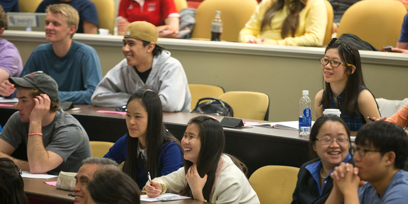 Students laughing and engaging in class