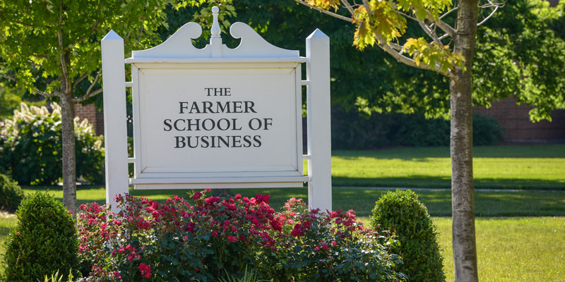 Farmer School of Business sign in flower bed