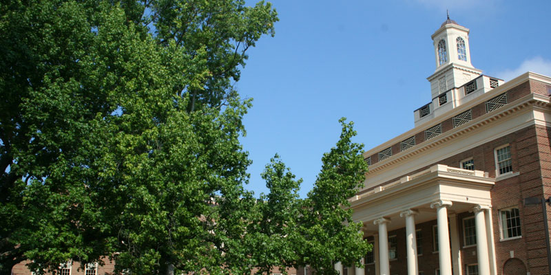 Angle shot of Farmer School of Business exterior and green tree