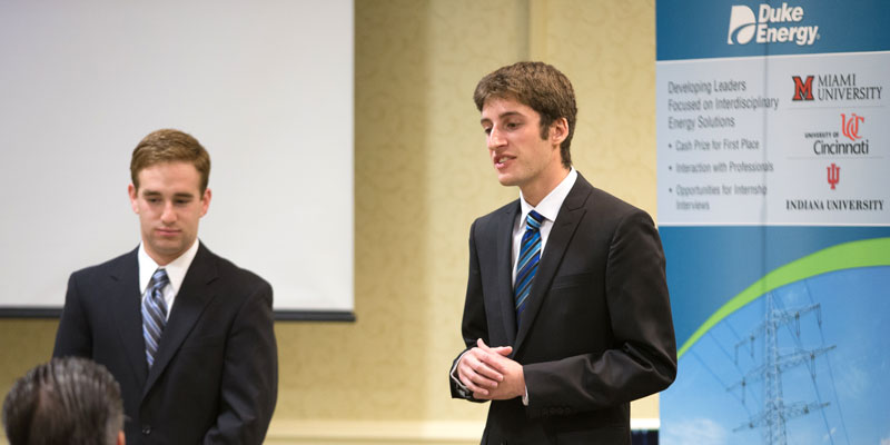 Two male students dressed in business suits present at the Duke Case Contest