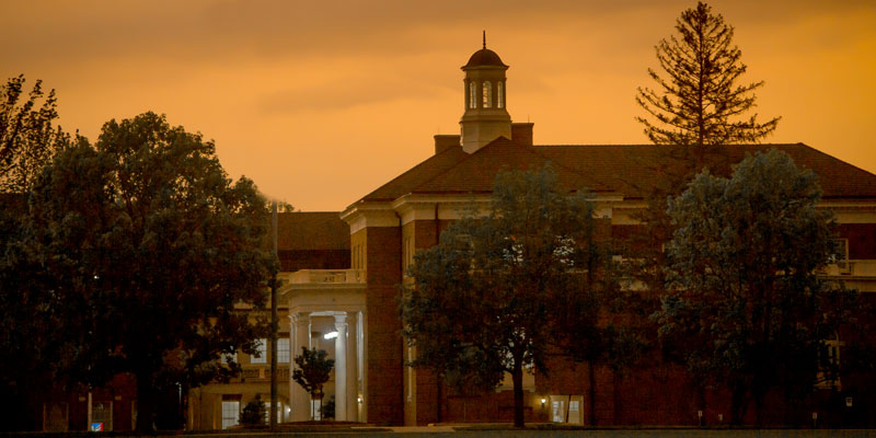 Exterior of Farmer School of Business at sunset