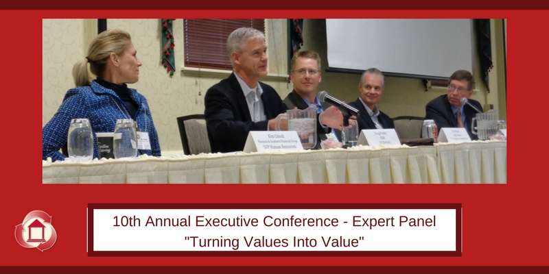 Panel of one woman and four men over red background. Text reads 10th Annual Executive Conference - Expert Panel