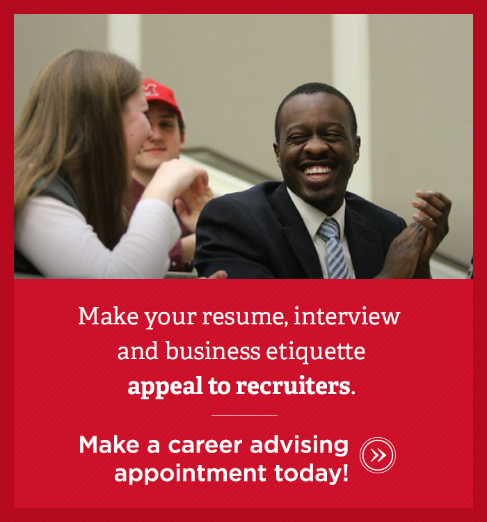 Want your resume, interviewing skills, and business etiquette to appeal to recruiters and employers? Two professionally dressed students, one Caucasian female and one African-American male, laugh together.