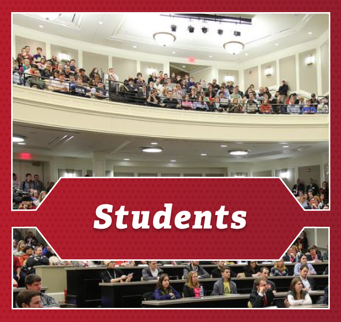 Students - a class of students in an auditorium in the Farmer School of Business