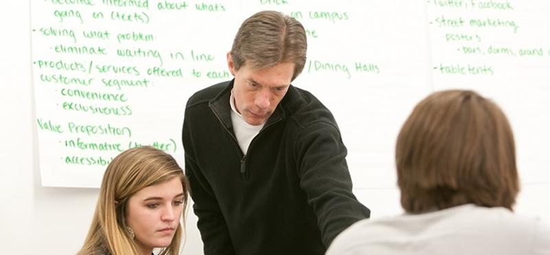 Professor Mark Lacker with students