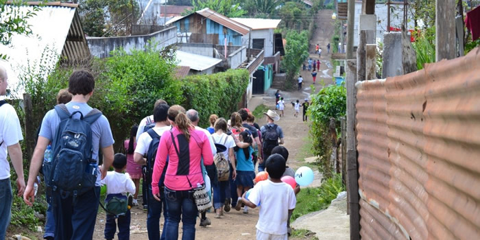 Students walk through third world village