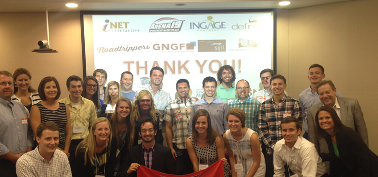 group of students and company representatives pose for a picture in front of a presentation that says, Thank you!