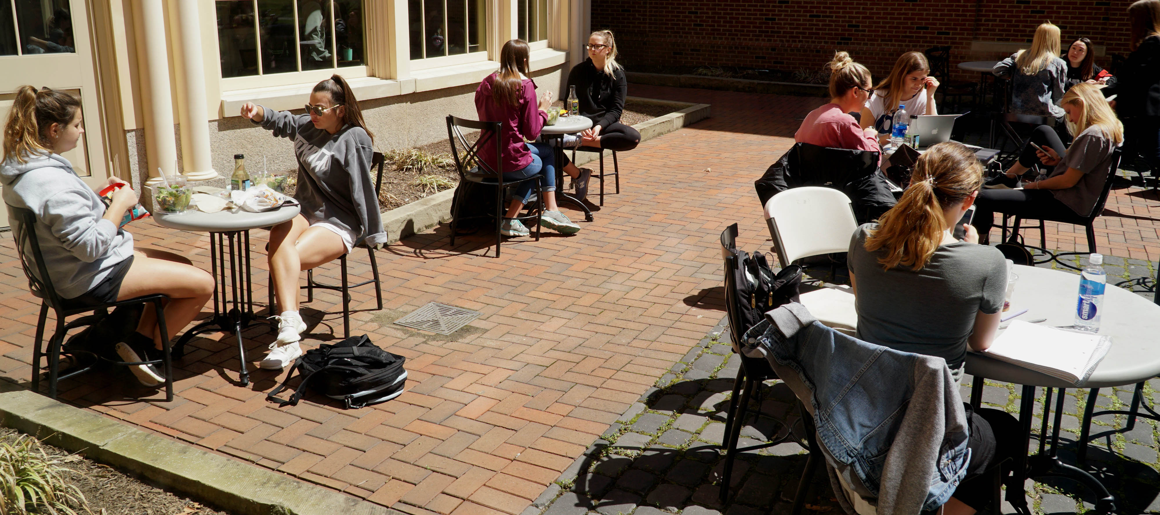 Students eating lunch and studying on FSB patio