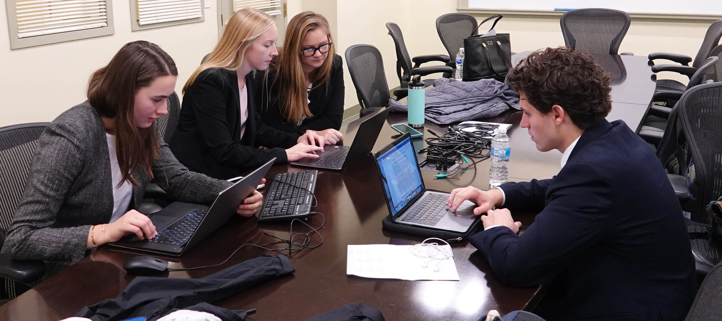 A West Monroe Partners case competition team goes over their project before the final presentations