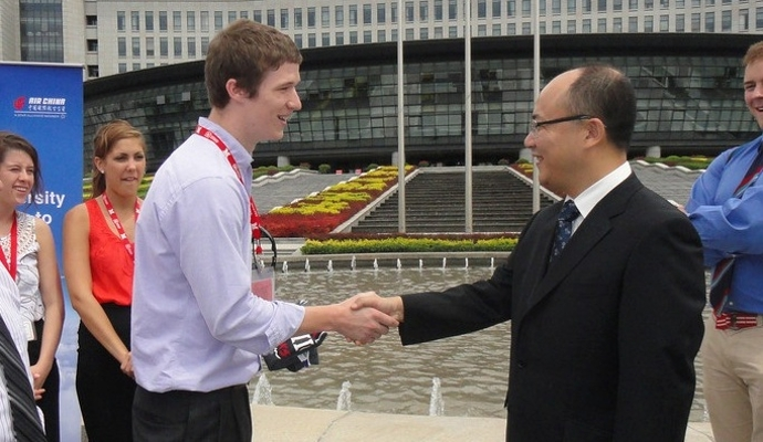 student and businessman shaking hands