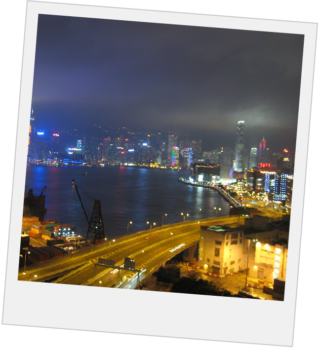 Polaroid of Hong Kong skyline at night, lit up by the bright building lights