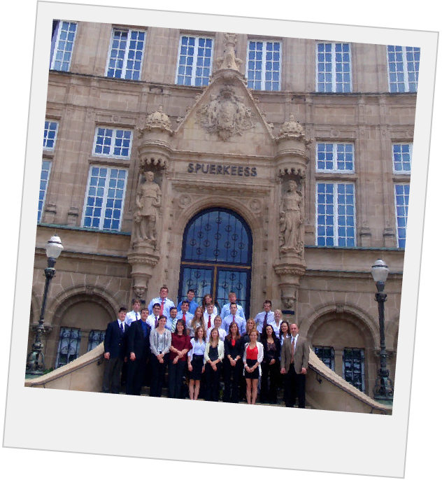 Polaroid of students in front of an old building with ornate architecture
