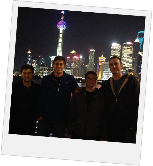 Polaroid of students in front of the shanghai skyline at night