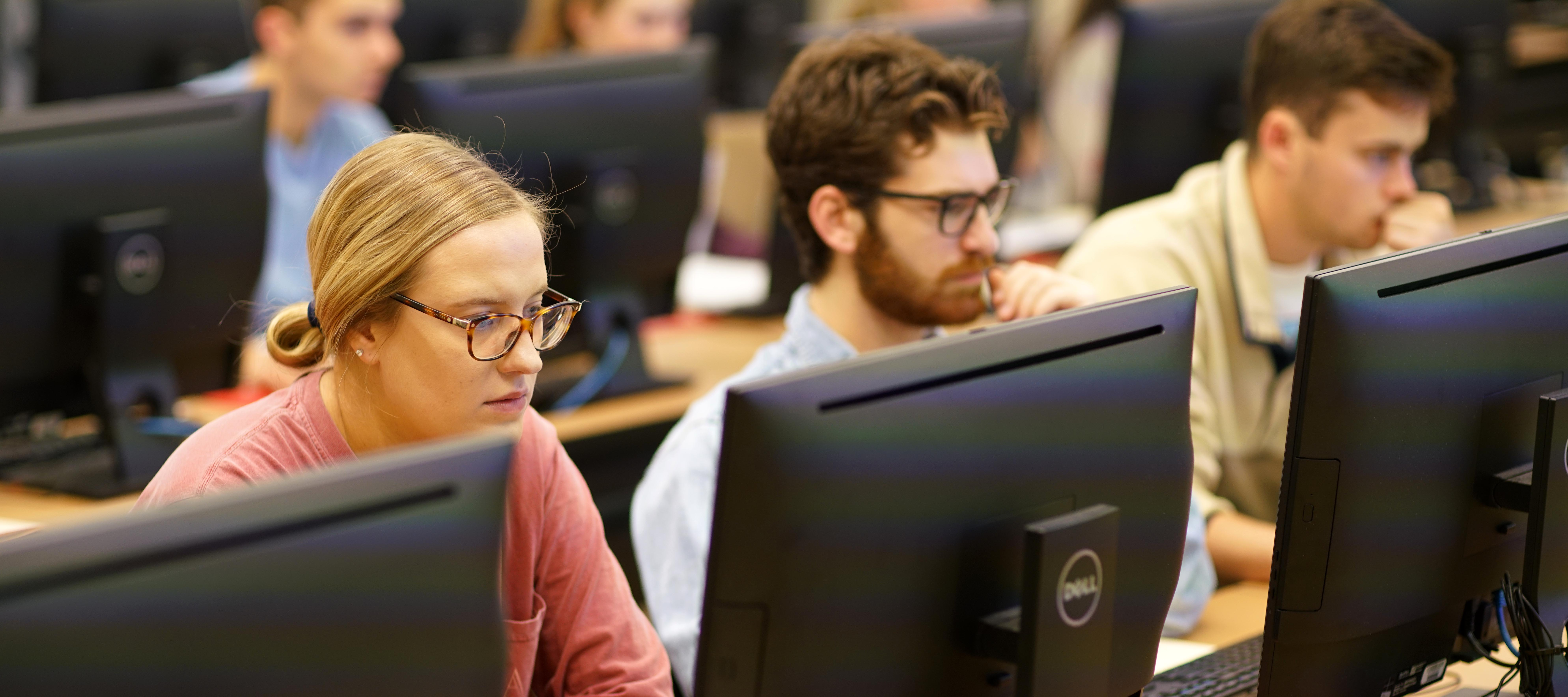 Students in class at computers