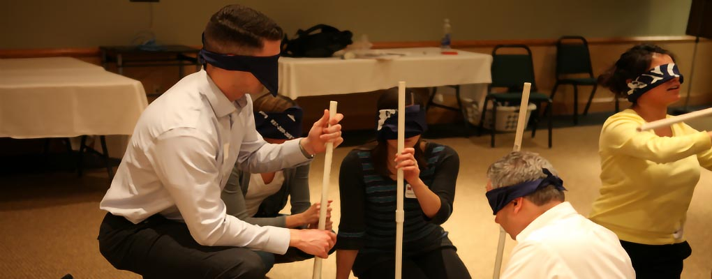Blindfolded students attempt to construct object in teams