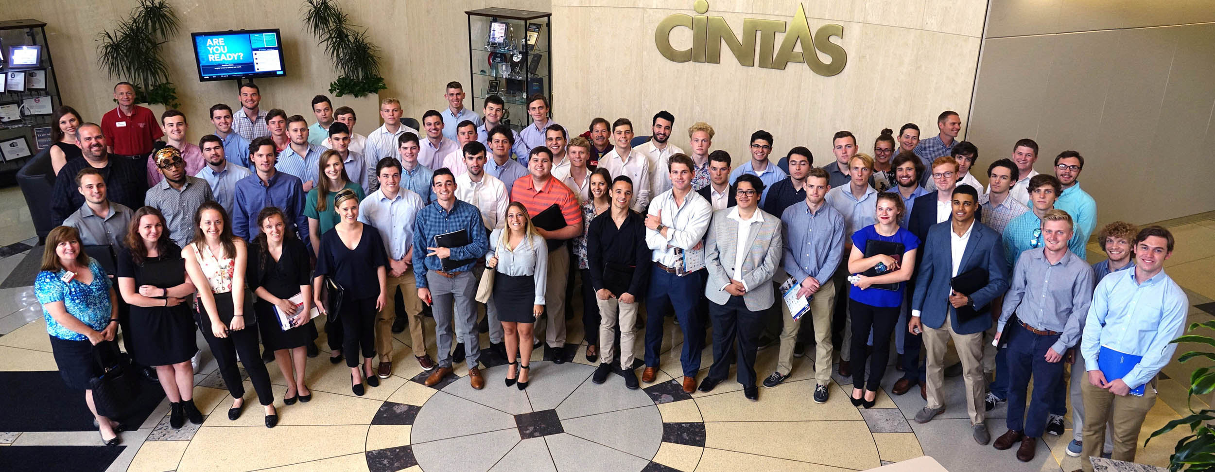 Group photo of Miami PRIME participants in Cintas' lobby