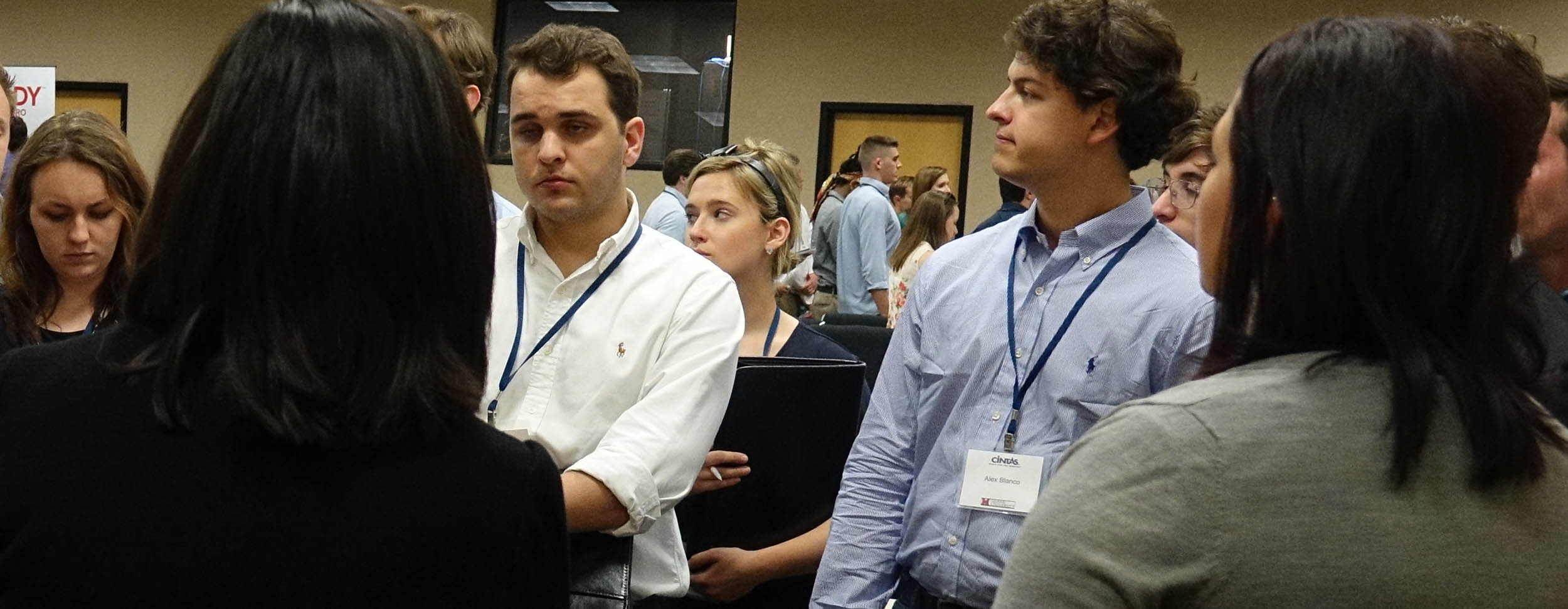 Students listen to Cintas executives talk about their businesses