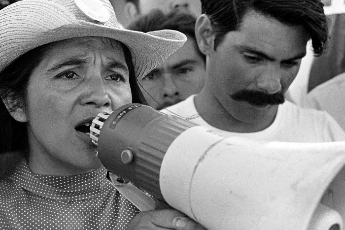 Woman speaking in megaphone, black and white, Dolores movie