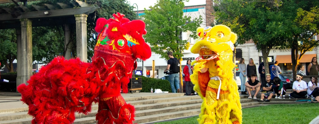 red and yellow lion performing uptown at the Chinese Festival