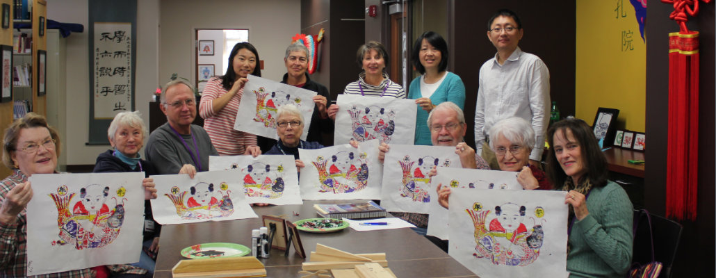 Participants showing Chinese paintings