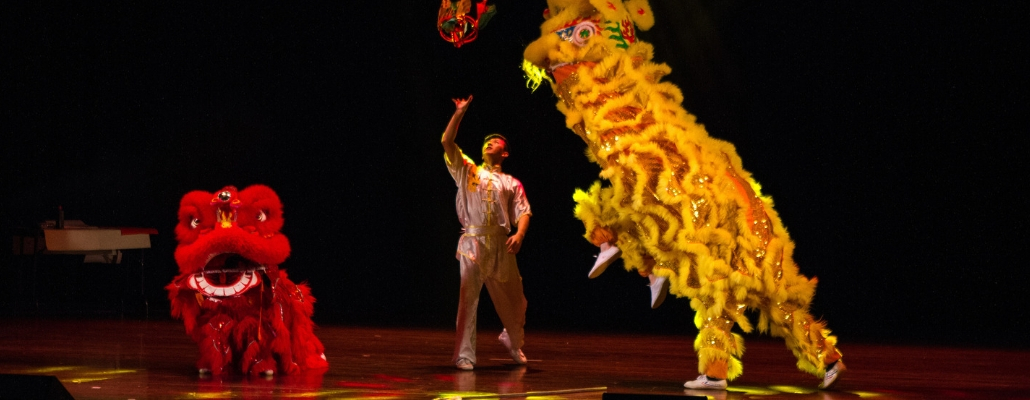 "Miami students on stage performing the ""lion dance"""