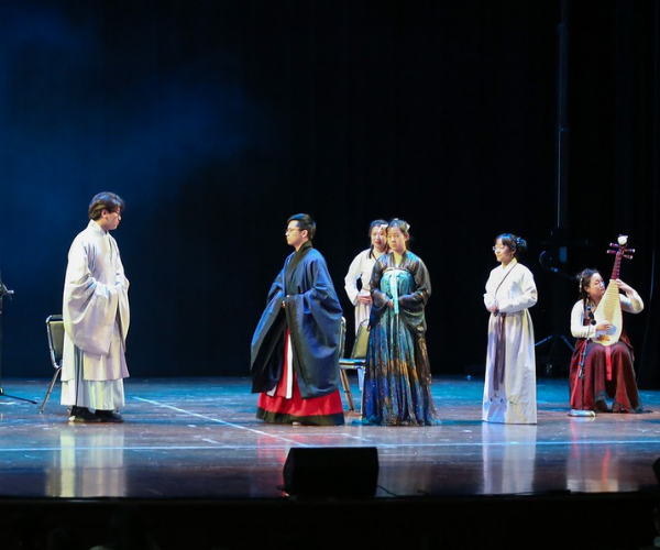 students from the Han Costume Club act out a skit onstage