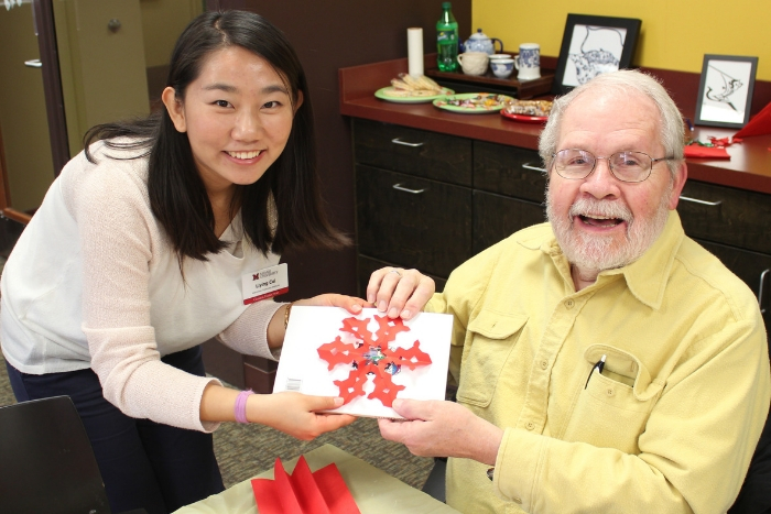 Miami ILR member (senior citizen) holding a Chinese craft with a Chinese instructor