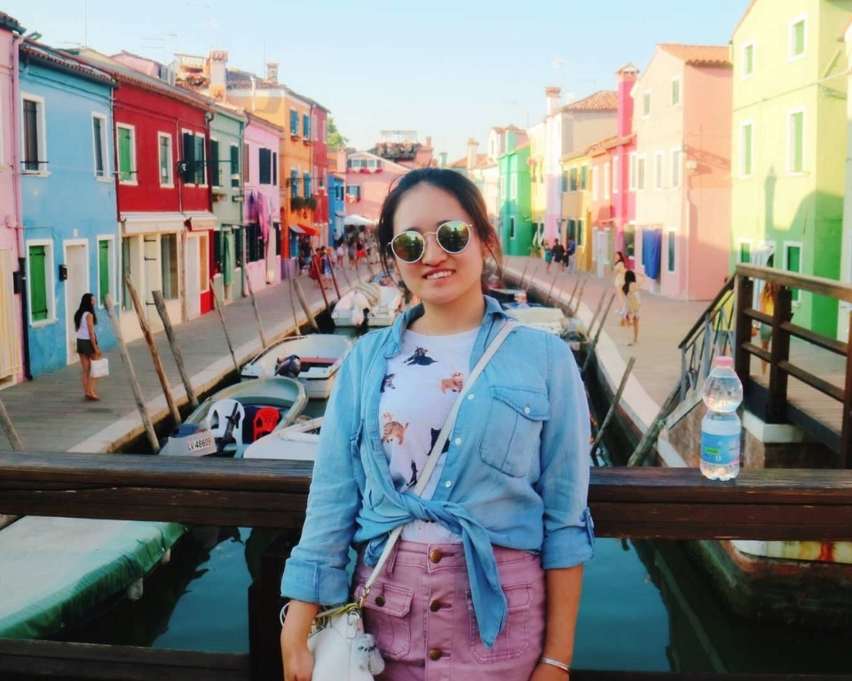 Miami student  in front of colorful buildings in Venice