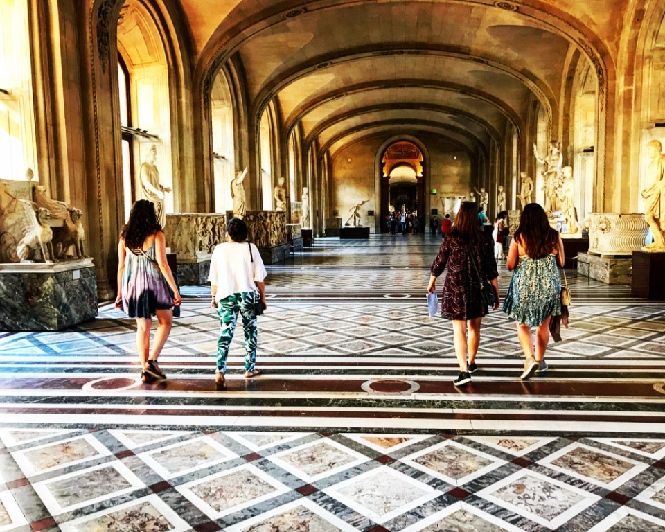 students walking through the Louvre in Paris