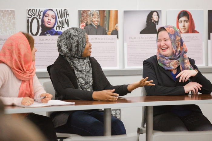 three women talking with each other and wearing the hijab
