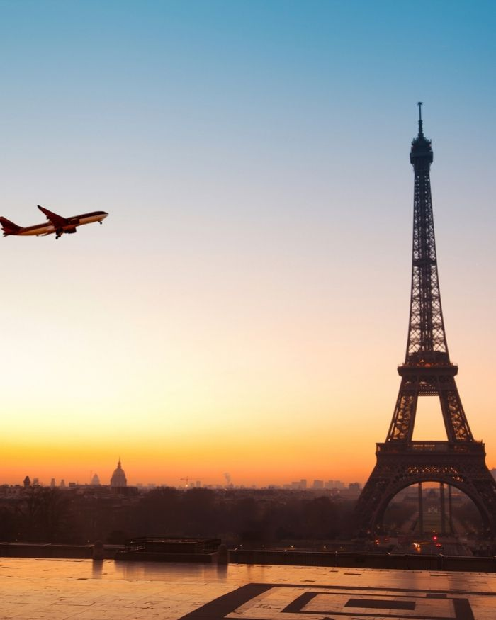 plane flying in Paris near Eiffel Tower