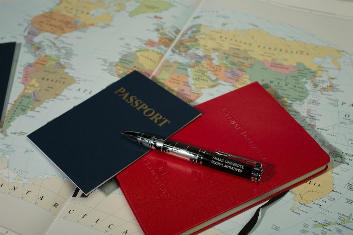 map, passport, pen