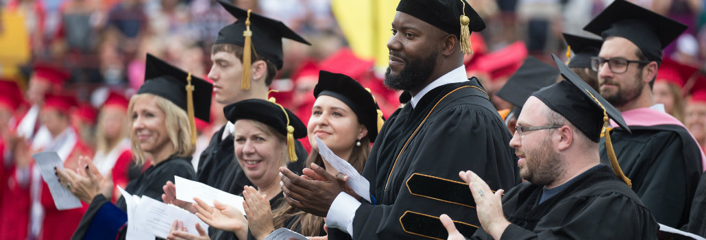 Line of doctoral degree candidates at May commencement