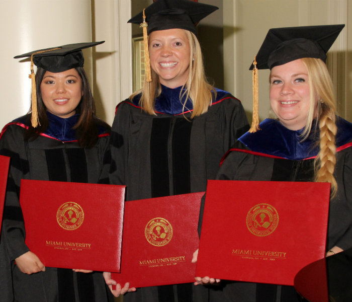 Group of graduate students with their diplomas