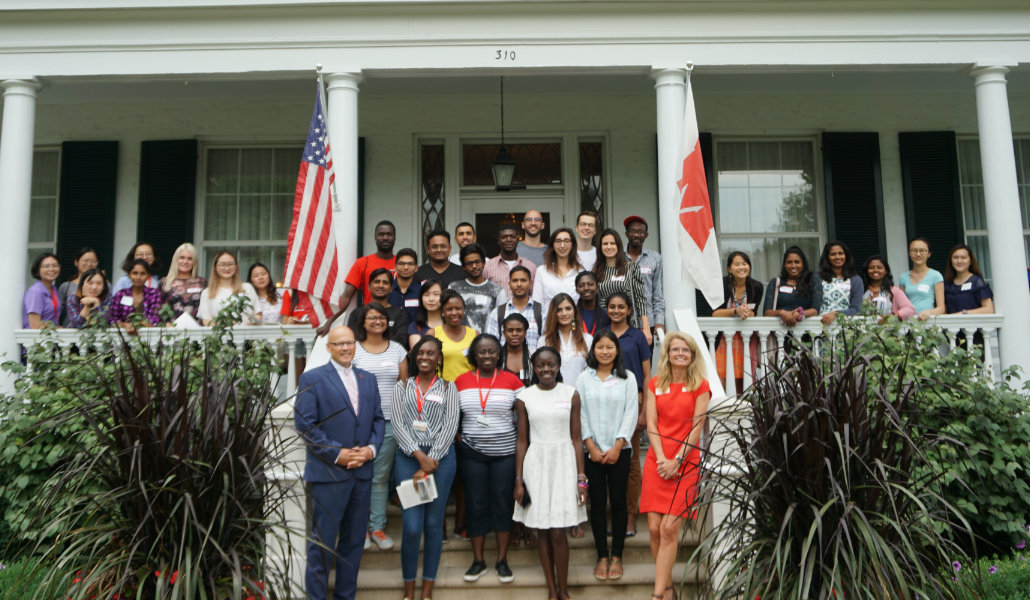 Group of international students in front of President Crawford's house
