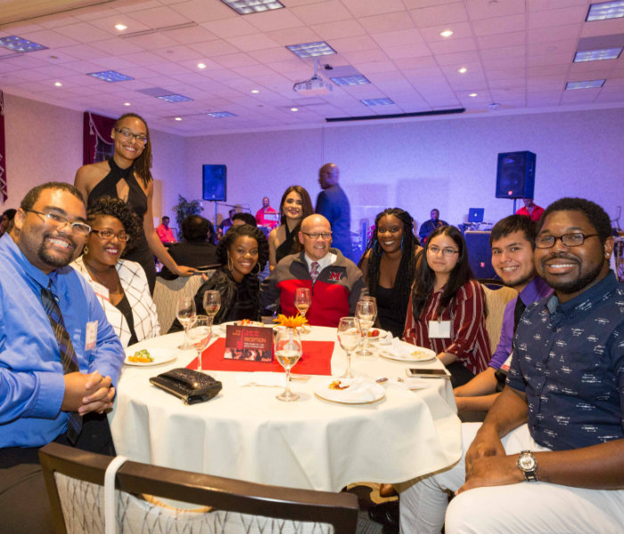 Students sitting with President Crawford during the 2017 jazz reception
