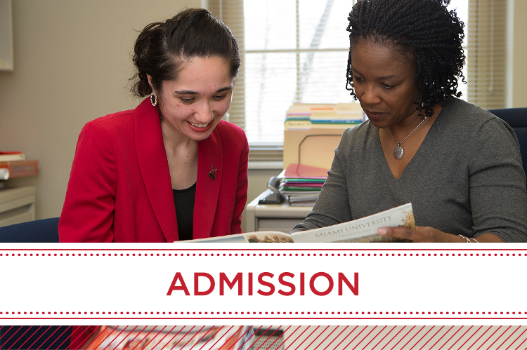 Admission. An advisor reviews admission information with a graduate student