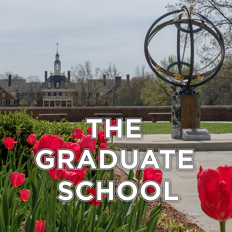 The Graduate School. Red tulips line the sidewalk leading up to the sundial.