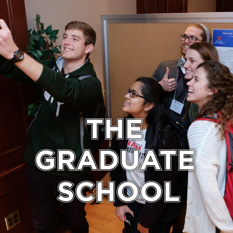 The Graduate School. Students take a selfie in front of a research poster