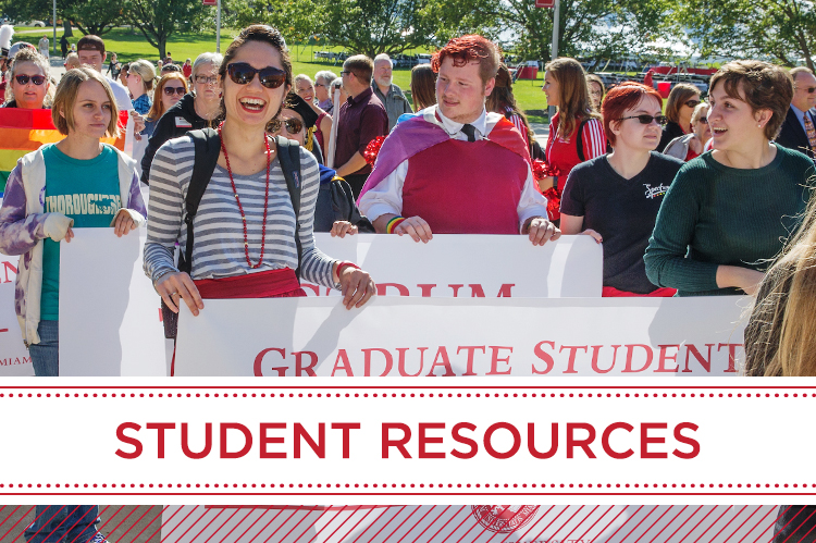 Student Resources. Students hold up a 'graduate student' banner in a parde