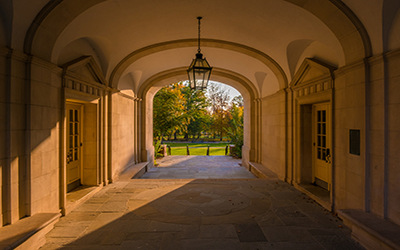 Sunlight streaming through Upham arch in the fall
