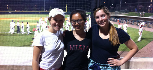 Girls together at a baseball game
