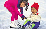 Two children skating