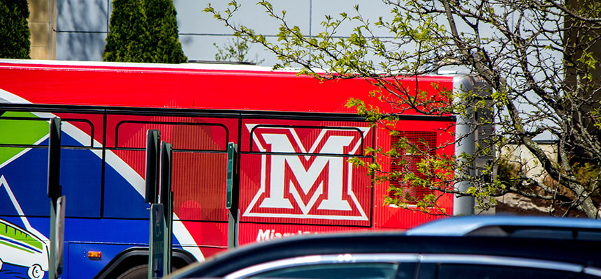 The back of the transit bus with a red Miami M.