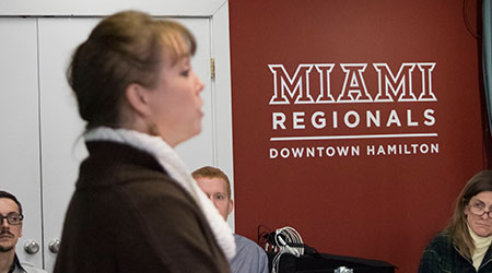 A woman speaking to a group of people at the Miami Hamilton Downtown center.