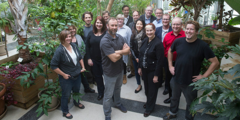 HCA Faculty standing in the conservatory